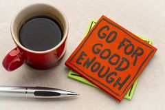 Go for good enough reminder note. With a cup of coffee stock photo