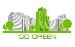 Go Green. Single green building shines among many grey buildings Royalty Free Stock Photos