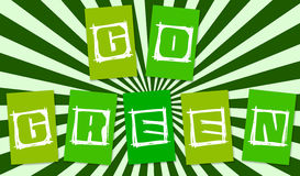 Go green. Letters with beams as a backdrop Stock Image