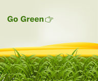 Go green. Green grass in front of gold hills with the words go green.  Vector format available Stock Photography