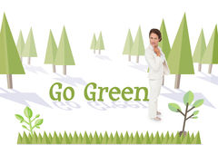 Go green against forest with earth tree Royalty Free Stock Images