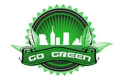 Go green badge. Isolated green badge with city buildings, leaves and the text go green written with white letters Royalty Free Stock Image