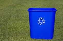 Go Green with a Blue Box. A blue recycling box on a green lawn Royalty Free Stock Photo