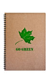 Go Green on brown notebook with green leaf. Stock Images