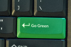Go Green button. On black keyboard Royalty Free Stock Images