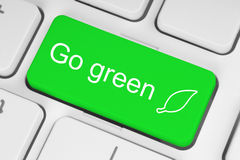 Go green button. On keyboard background Stock Image