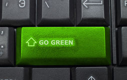 Go green button on keyboard background. Close-up Stock Image