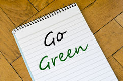 Go green concept on notebook. Go green text concept write on notebook Royalty Free Stock Photo