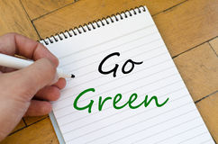 Go green concept on notebook. Go green text concept write on notebook Royalty Free Stock Images