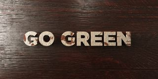 Go green - grungy wooden headline on Maple  - 3D rendered royalty free stock image. This image can be used for an online website banner ad or a print postcard Stock Photography