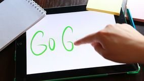 Go green - hand write text on tablet stock footage