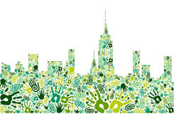 Go green hands city skyline background Stock Photo