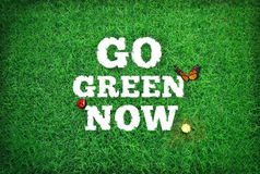 Go Green Now. Wallpaper image background Stock Photo