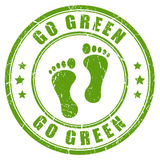 Go green rubber vector stamp Stock Photo