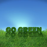 Go Green sign over fresh grass. Textured go green sign over fresh grass. Clear blue sky background Stock Images