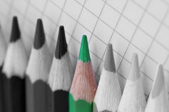 Go green, single coloured pencil in bw image. Single green colored pencil in selecetive coloured image royalty free stock images