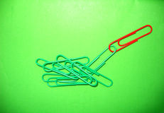 Go green (symbolic). Green clips (with one red) on the green background as symbolic representation to go green Stock Photography