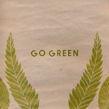 Go green text on craft paper and green traces of Stock Image