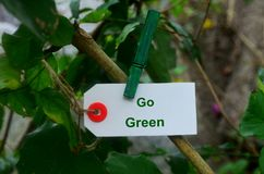 White card holding by a clothespin in the nature. Royalty Free Stock Images