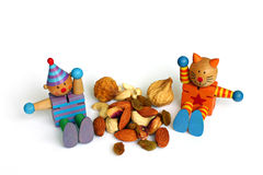 Go for Healthy Snacks!. Two happy toy figurines help to bring the message across: Eat Healthier Snacks! Choose dried fruit and nuts.  They are high in proteins Stock Images