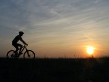 Go home. Mountain biker stock photos