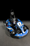 Go-Kart. Product type of photo of a Go-Kart on the track, fading into a black background Royalty Free Stock Photo
