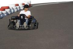Go-kart. Man racing in go kart go-kart on the race track Stock Photography