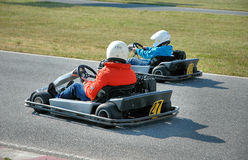 Go kart. Pilots on a fast racing circuit Stock Photography