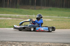 Go kart. Girl in racing kart with number one Stock Photos
