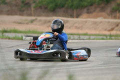 Go kart. Girl in racing kart with number one Royalty Free Stock Photography