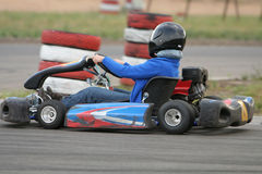 Go kart. Girl in racing kart with number one Stock Image