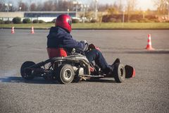 Go-kart competitions, go-kart driver drives a kart, close-up, rushes to the finish, winner stock photo