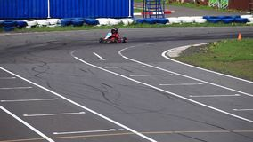 Go-kart in a curve front view Royalty Free Stock Photo