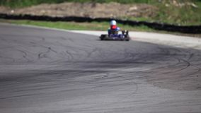 Go-kart in a curve rear view stock footage