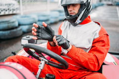 Go-kart driver in helmet on karting speed track Royalty Free Stock Photos