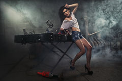 Go-kart. Girl at a garage next to the Go-kart  in smoke Stock Photography