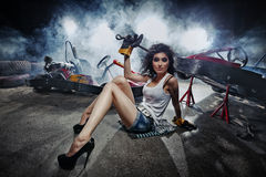 Go-kart. Girl at a garage next to the Go-kart  in smoke Royalty Free Stock Images