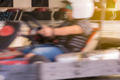 Go-Kart. Motion blurred children drive a Go-Kart Royalty Free Stock Photos