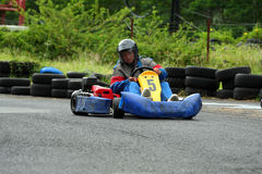 Go kart number five. Go kart pilot with number five Royalty Free Stock Photo