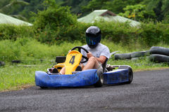 Go kart pilot. With number four Royalty Free Stock Photo