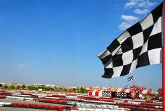 Go kart race flag. A start flag on a blue sky stock photos