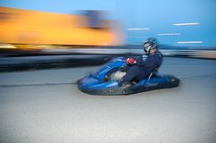 Go-kart racing. Panning shot of a go-kart racer outdoors. Vivid colours and dynamic feel Stock Photo