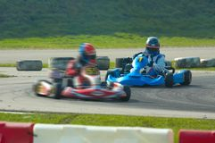 Go kart racing. On circuit Royalty Free Stock Photo