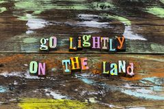 Go lightly on land nature natural habitat ecosystem protect. Letterpress living life conservation bio leave footprints hiking trail trails climate change stock photography