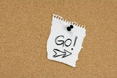Go message on pinboard Stock Photos