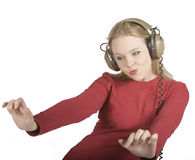 Go With The Music. Young woman dancing to the music she hears inside the headphones Stock Images