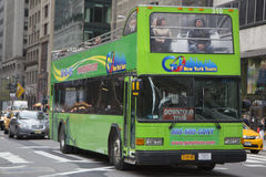 Go NY tour Hop on Hop off bus in Manhattan. NEW YORK - APRIL 27:Go NY tour Hop on Hop off bus in Manhattan on March 20, 2014. Go NY tours provides variety of New Stock Photo