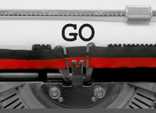 Go by the old typewriter on white paper Stock Images