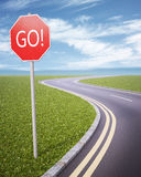 GO! road sign. An empty road with the sign GO Royalty Free Stock Photo