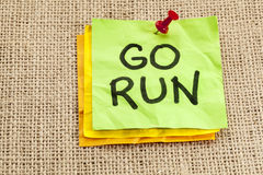 Go run reminder. Or fitness concept - handwriting on green sticky note Stock Images